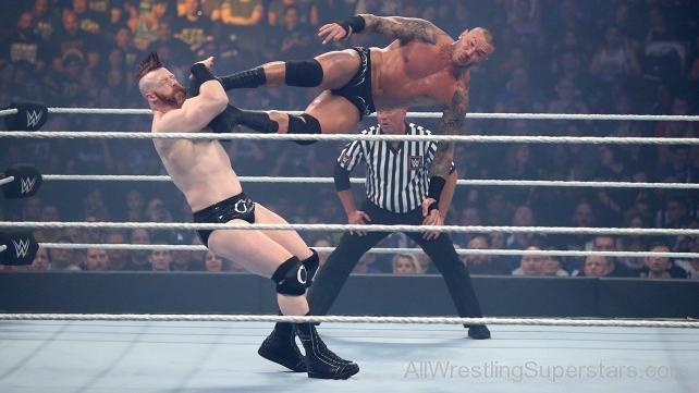 Randy-Orton-Applying-Flying-Kick-On-Shea